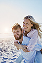 Portrait of happy couple on the beach - RORF00803