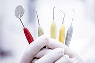 Hand holding dental instruments - WESTF22942