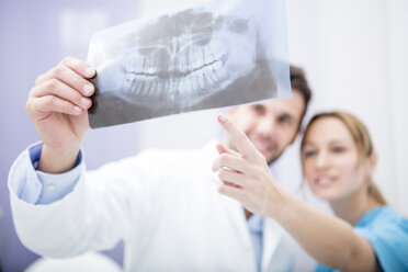 Two doctors discussing dental x-ray image - WESTF22984