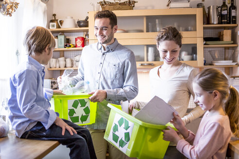 Family at home with waste boxes - WESTF23044