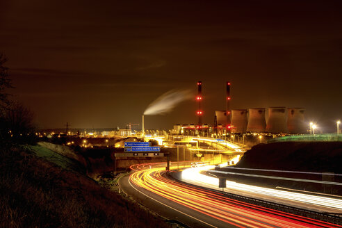 UK, England, West Yorkshire, view to Ferrybridge power station by night with motorway in the foreground - SMAF00738
