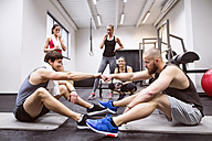 Athletes having a break from exercising in gym - HAPF01637