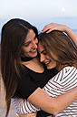 Portrait of two hugging young women - KKAF00743