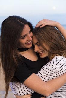 Portrait of two hugging young women - KKAF00743