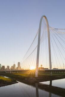 USA, Texas, Dallas, Margaret Hunt Hill Bridge and skyline at sunrise - FOF09232