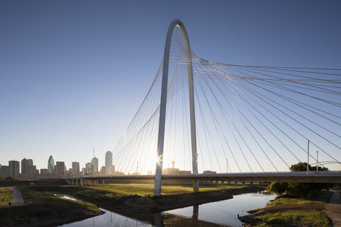 USA, Texas, Dallas, Margaret Hunt Hill Bridge and skyline at sunrise - FOF09235