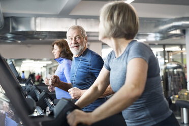 Group of fit seniors on treadmills working out in gym - HAPF01643