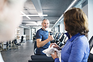Group of fit seniors on treadmills working out in gym - HAPF01646