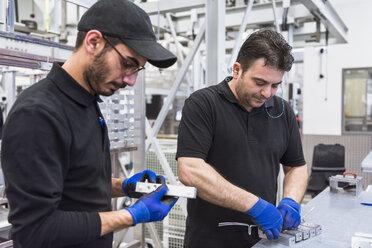 Two men working in factory shop floor - DIGF02358