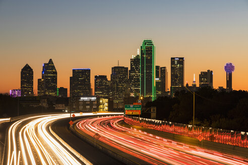 USA, Texas, Dallas, skyline and Tom Landry Freeway, Interstate 30 at night - FOF09237