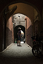 Morocco, young tourist standing in a passage looking up - KKAF00756