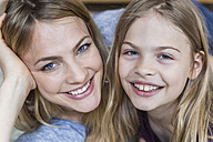 Portrait of happy little girl with her mother - TCF05393