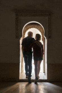 Morocco, Marrakesh, couple leaving building - KKAF00768