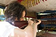 Man shooting at shooting gallery - KKAF00804