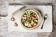 Smoothie Bowl with strawberries, banana, kiwi and slices almonds - EVGF03219