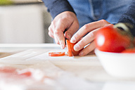 Man's hands chopping tomato - FMOF00256