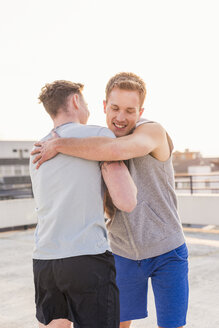 Friends embracing after training - UUF10632