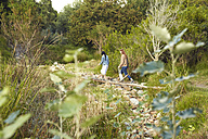 Two young women walking in nature - SRYF00467