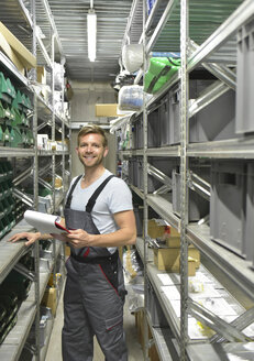 Portrait of smiling man in warehouse - LYF00707