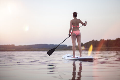 Germany, Bavaria, Chiemsee, woman on SUP Board - MMAF00067
