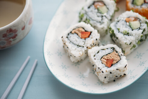 Sushi rolls on a plate with green tea - IPF00375