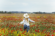 Woman walking in a flower field - JPF00189