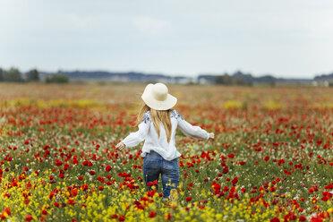 Woman walking in a flower field - JPF00189