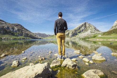 Spain, Asturias, Picos de Europa National Park, man standing at Lakes of Covadonga - EPF00440