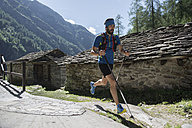 Italy, Alagna, trail runner on the move near Monte Rosa mountain massif - ZOCF00256