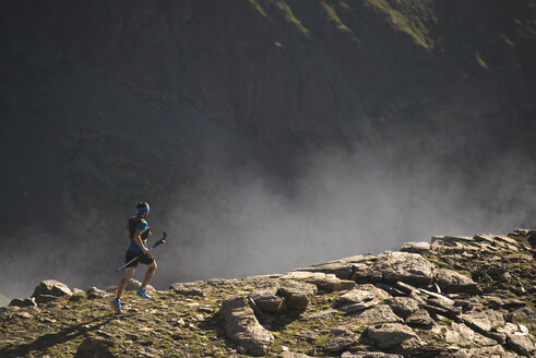 Italy, Alagna, trail runner on the move near Monte Rosa mountain massif - ZOCF00277