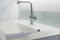 Toothbrush at bathroom sink - CHPF00400