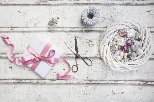 Christmas decoration, scissors and Christmas present on wood - LVF06086