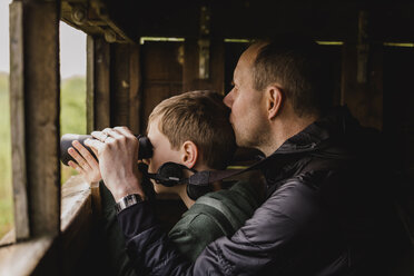 Boy and father birdwatching with binoculars - NMSF00077