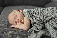 Newborn baby boy sleeping on couch - OJF00192