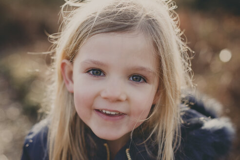 Portrait of a smiling girl outdoors - NMSF00085
