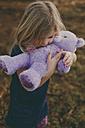 Girl cuddling a teddy - NMSF00088