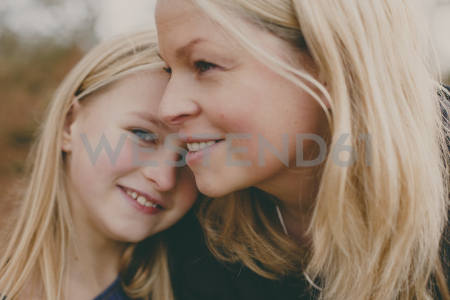 Happy mother with daughter outdoors - NMSF00097
