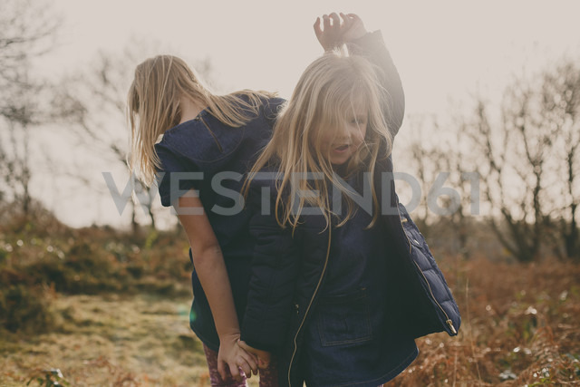Two sisters dancing on a meadow - NMSF00100