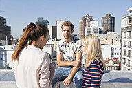 Friends meeting on a rooftop terrace in summer - WESTF23089