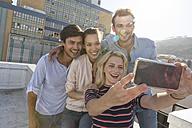 Friends taking selfies on a rooftop terrace - WESTF23101