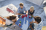 Friends having a rooftop party on a beautiful summer evening - WESTF23116