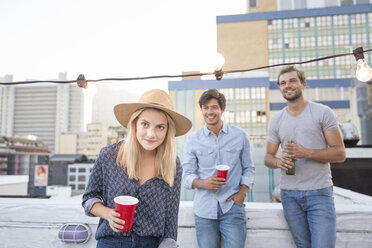 Friends having a rooftop party on a beautiful summer evening - WESTF23137