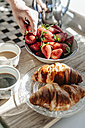 Strawberries, croissants and coffee in kitchen - JOSF00778