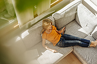 Woman at home on couch with tablet - JOSF00853
