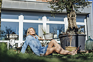 Woman relaxing in garden - JOSF00862