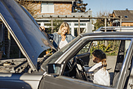 Smiling mature woman and girl with vintage car - JOSF00868