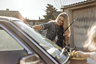 Mature woman and girl cleaning car together - JOSF00871