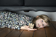 Girl lying on floor holding box with painted mouse - PSTF00006