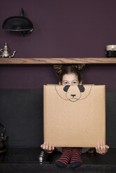 Girl inside a cardboard box painted with a panda - PSTF00015