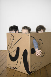 Three boys inside a cardboard box painted with an octopus - PSTF00021